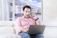 Handsome person speaking with cellphone Stock Photo