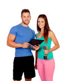 Handsome personal trainer with a attractive girl Stock Images