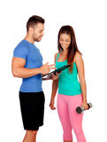 Handsome personal trainer with a attractive girl Royalty Free Stock Photography