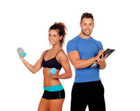 Handsome personal trainer with beautiful girl with dumbbells. Isolated on white royalty free stock photos