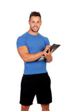 Handsome personal trainer with a clipboard Royalty Free Stock Photo