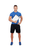 Handsome personal trainer with a clipboard. Isolated on a white background Royalty Free Stock Images