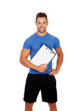 Handsome personal trainer with a clipboard. Isolated on a white background Royalty Free Stock Photo