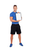 Handsome personal trainer with clipboard. Isolated on a white background Royalty Free Stock Photos