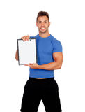 Handsome personal trainer with clipboard. Isolated on a white background Stock Images