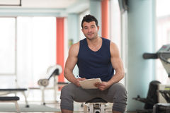 Handsome Personal Trainer With A Clipboard. Personal Trainer Takes Notes On Clipboard In a Gym Stock Photography