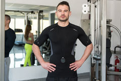Handsome Personal Trainer Standing Strong In A Gym Royalty Free Stock Photography