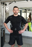 Handsome Personal Trainer Standing Strong In A Gym Royalty Free Stock Image