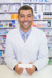 Handsome pharmacist holding medicine box Stock Images