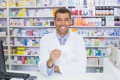 Handsome pharmacist holding paper Stock Image