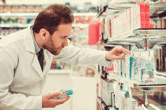 Handsome pharmacist at work stock photography