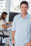 Handsome photo editor standing with hands in pocket Stock Photography