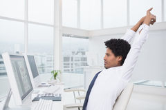 Handsome photo editor working at desk Stock Photos