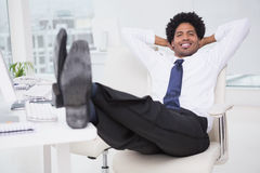 Handsome photo editor working at desk Royalty Free Stock Images