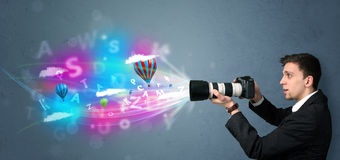 Handsome photographer with camera and abstract imaginary Stock Photo