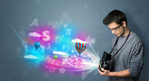 Handsome photographer with camera and abstract imaginary Royalty Free Stock Image