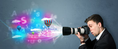 Handsome photographer with camera and abstract imaginary Stock Images