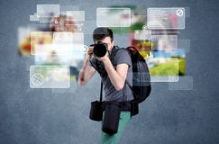 Handsome photographer with camera Royalty Free Stock Photo