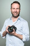 Handsome photographer with a friendly smile Stock Photography