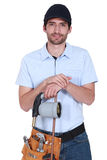 Handsome plumber wearing cap Stock Photography