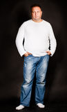 Handsome  plus size man wearing jeans Royalty Free Stock Images