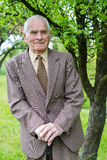 Handsome 80 plus year old senior man posing for a portrait in his garden Royalty Free Stock Photos