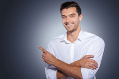 Handsome pointing copy space. Royalty Free Stock Photography