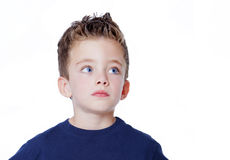 Handsome portrait of a boy looking to the side. On a white background Royalty Free Stock Photo