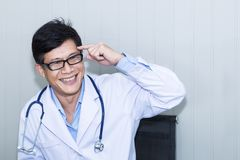 Handsome portrait man of mature doctor with white coat royalty free stock photos