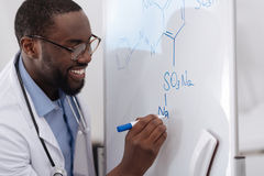 Handsome positive scientist doing chemical research Royalty Free Stock Image