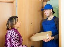 Handsome postman delivered box Stock Images