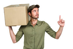 Handsome postman holding pack looking up Royalty Free Stock Photography