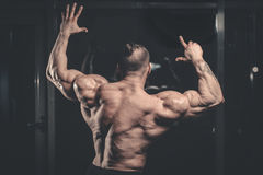 Handsome power athletic man diet training pumping up back muscle Royalty Free Stock Image