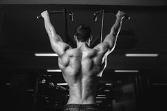 Handsome power athletic man diet training pumping up back muscle Royalty Free Stock Images