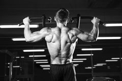 Handsome power athletic man diet training pumping up back muscle Royalty Free Stock Photography