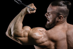 Handsome power athletic man on diet training pumping up muscles Royalty Free Stock Images