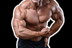 Handsome power athletic man on diet training pumping up muscles. With dumbbell and barbell. Strong bodybuilder with six pack, perfect abs, shoulders, biceps Royalty Free Stock Image