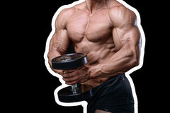 Handsome power athletic man on diet training pumping up muscles. With dumbbell and barbell. Strong bodybuilder with six pack, perfect abs, shoulders, biceps Stock Image