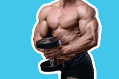Handsome power athletic man on diet training pumping up muscles. With dumbbell and barbell. Strong bodybuilder with six pack, perfect abs, shoulders, biceps Royalty Free Stock Images