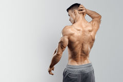 Handsome power athletic man turned back Royalty Free Stock Image