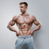 Handsome power athletic young man with great physique Stock Images