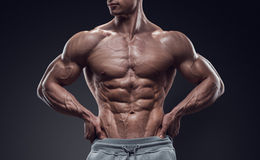 Handsome power athletic young man with great physique Royalty Free Stock Photography