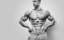 Handsome power athletic young man with great physique Royalty Free Stock Photos