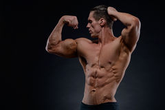 Handsome power athletic young man with great physique. Stock Photography