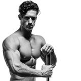 Handsome power athletic young man with great physique. Royalty Free Stock Photo