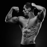 Handsome power athletic young man with great physique. Royalty Free Stock Images