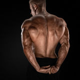 Handsome power bodybuilder showing his back Royalty Free Stock Photos