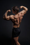 Handsome power bodybuilder showing his back Stock Photo
