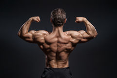 Handsome power bodybuilder showing his back Royalty Free Stock Image