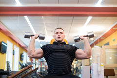 Handsome powerful athletic man doing barbell shoulder press exercise. Strong bodybuilder with perfect muscles. Handsome powerful athletic man doing barbell stock photos